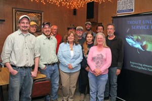 """Members of the Mountaineer Chapter of Trout Unlimited held a meeting at the Upper Inn Club in Durbin on Monday evening. Chapter President Buck Edwards, pictured fourth from the left, described plans to hold local """"sub-chapters"""" to plan and conduct local activities. Chapter Vice President and Upper Inn manager Laura Dent is pictured second from the right."""