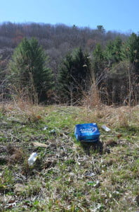 What should be a beautiful landscape in Pocahontas County is ruined by  litter. This scene could be anywhere in the county but is along a popular fishing spot on Knapps Creek near Frost. G. Hamill photo.