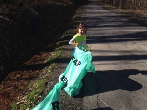 Lily Epling, the granddaughter of Tom Epling, of Stony Bottom, helps clean up litter on April 11. A community group organized by Bob Runyon cleans up the Stony Bottom area every spring. Photo courtesy Tom Epling.
