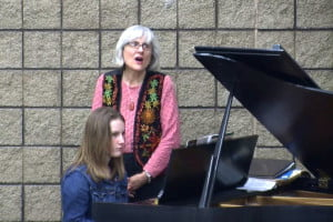 Music instructor Julia Bauserman (standing) and Marilyn Creager performed a free concert at the National Radio Astronomy Observatory in Green Bank on Friday night. A video of concert highlights can be found on The Pocahontas Times website in the Video section of the site.