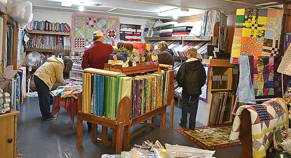 Customers at Deb Ann's Fabrics in Hillsboro peruse fabrics in the new section of the store. Owner Deb Ann Walker said she had to expand the store to accommodate her customers' needs. S. Stewart photo