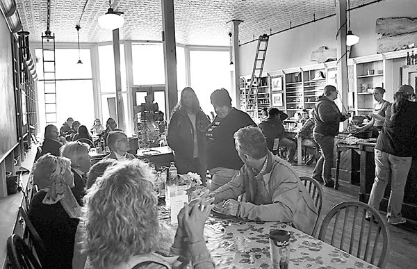 Pretty Penny Café owner Blair Campbell, center, visits with customers at the restaurant during its last evening of business Saturday. The restaurant went out in style with a buffet dinner and music by the Black Mountain Bluegrass Boys. S. Stewart photo