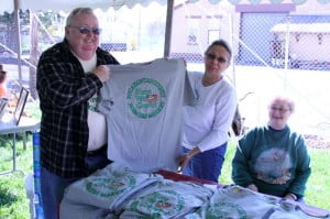 Members of the Pocahontas County Farmers Market show off a custom-designed t-shirt during the Wild Edibles festival. Pictured left to right: Joe Laskey, Sandy Irvine and Sue Laskey. Sales of the t-shirt benefit the Farmers Market. For more information, call 304-799-6542.
