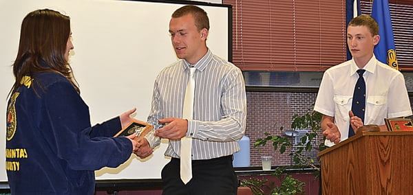 Logan Dilley, right, looks on as Ryan Irvine presents the Leadership Award to FFApresident Kindra Carr at the FFAbanquet Thursday night. S. Stewart photo