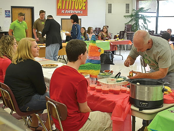Students shared their culinary creations in the food competition portion of the Foreign Language Festival Saturday. Judges were agriculture education teacher Erwin Berry, right, assistant principal Michael Adkins and his wife, Asaco. S. Stewart photo