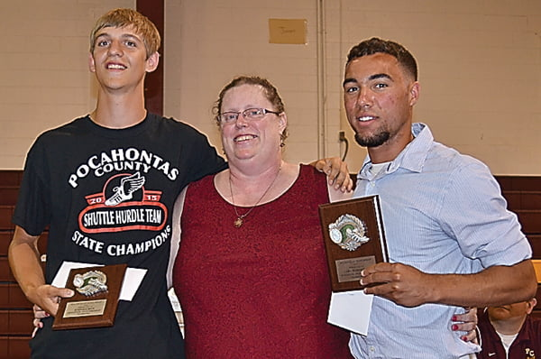 Receiving the William Dilley Track Scholarship Award were Stephen Mick, left, and Cary Robertson, right. The award was presented by Mali Minter, center. S. Stewart photo