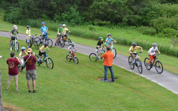 Young bicycle enthusiasts prepare to race one another at the 4th annual Space Race Rumpus at the National Radio Astronomy Observatory in Green Bank this past weekend. Cyclists of all ages participated in the event which included races, trail rides and musical entertainment. S. Stewart photo