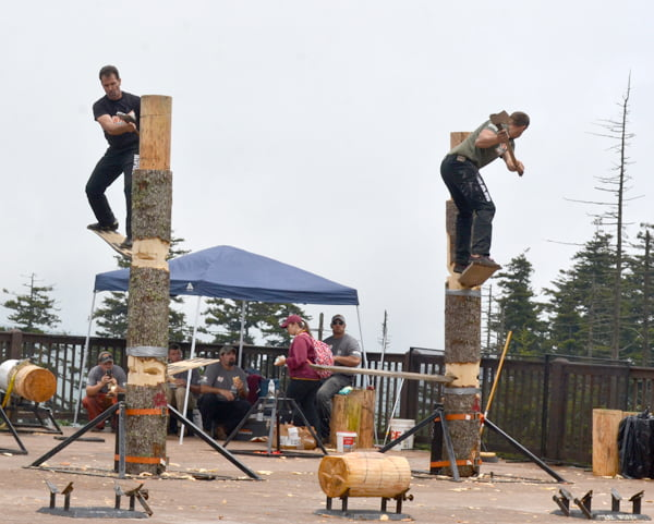 Mike Sullivan, left, of Colebrook, Connecticut; and Jason Lentz, of Diana compete in the Springboard Chop event at the Stihl Timbersports Mid-Atlantic Pro Qualifier at Snowshoe Mountain Resort Saturday. The top five competitors will move on to the finals which will be held in New York City this weekend. S. Stewart photo