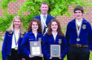 The Pocahontas County High School Forestry team, led by teacher Scott Garber, center, placed first at the FFACareer Development Event in Morgantown. From left, Makayla Marks, Melissa Murphy, Michelle Murphy and Caleb Bennett. Photo courtesy of Melissa Ferrell, Country Roads Photography