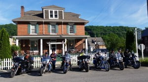 MOTORCYCLISTS FROM ILLINOIS made an intentional stop in Marlinton last week. The group had read in Rider magazine about the Old Clark Inn as well as  a recommended motorcycle trip through Williams River. They took a day ride to Warm Springs Wednesday, before heading to Pennsylvania and New York Thursday. Photo courtesy of Old Clark Inn