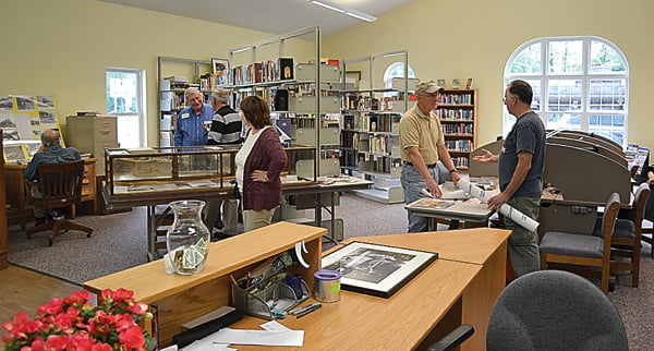 The spacious main room of the Durbin Community Library has an inviting atmosphere for those looking for a book to read or information from the World Wide Web.  At Saturday's opening, visitors learned about the history of Durbin and surrounding areas. Enjoying the new space, from left:Bill McNeel, Jason Bauserman, Bruce McKean, Kathy Henry, Tim Henry and Terry Hackney. S. Stewart photo