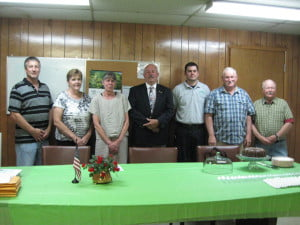 "Marlinton Town Council chamber was filled to near capacity June 30 for the swearing-in ceremony for the new mayor and council. Family and friends offered their enthusiastic support as Pocahontas County Clerk Melissa Bennett administered the oath of office to the mayor and each individual member of the council. Each pledged ""to support the Constitution of the United States, the Constitution of West Virginia, and the Ordinances of the Town of Marlinton"" and to faithfully discharge the duties, to the best of their skill and judgment, of the office to which they were elected.  Pictured, l to r: councilmembers Mark Strauss and Sue Helton, recorder B.J. Gudmundsson, Mayor Sam Felton, councilmembers Adam Irvine, Don Morrison and Norris Long. J. Graham photo"
