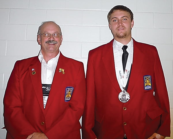 Pocahontas County High School carpentry teacher Duane Gibson, left, and recent graduate Travis Taylor at the National SkillsUSA contest where Taylor won second place in the carpentry competition. Photo courtesy of Duane Gibson