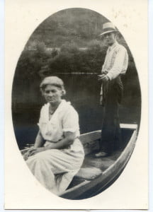 Sam Arbogast's grandfather and grandmother, Dennis and Elizabeth Simmons Dunn, in the boat they used to ferry residents to and from the old town of Watoga.
