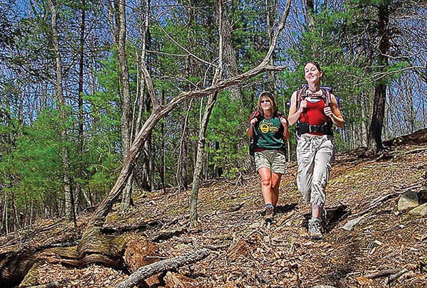 Photo Courtesy of the West Virginia Department of Commerce Women are exposed to dozens of seminars during the Becoming an Outdoors Woman program offered by the West Virginia Division of Natural History. The weekend event will be held this year at Watoga State Park.