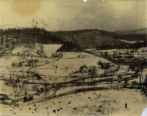 A VIEWFROMBuckeye Hill shows the town of Buckeye on the east side of the river. The American and Column Lumber Company can be seen along the river's edge. The photo would have been taken between 1914 and 1917 when the mill was in operation there. Photo courtesy of R. Shearer