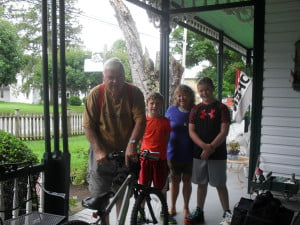 Gene Burford makes some last minute adjustments before the B&B's guests depart. Pictured with Gene are Sheri Saxe, of Highland, Michigan, and her grandsons, Noah and Gabriel, of Brighton, Michigan.