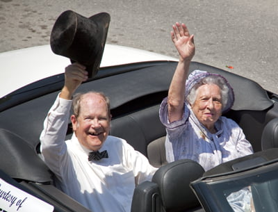 Jane Price Sharp and her nephew, Bill McNeel, wave to the crowd as they ride through the 2011 Pioneer Days Parade. G. Hamill photo