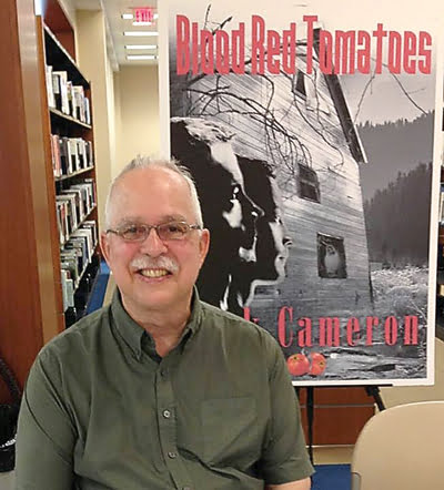 "John Dean, a native of Watoga and former Cleveland, Ohio resident, is writing a series of true crime novels based on two cold case murders which occurred in Pocahontas County in the 1970s. The first book of the triliogy is titled ""Blood Red Tomatoes."" Photo courtesy of John Dean"