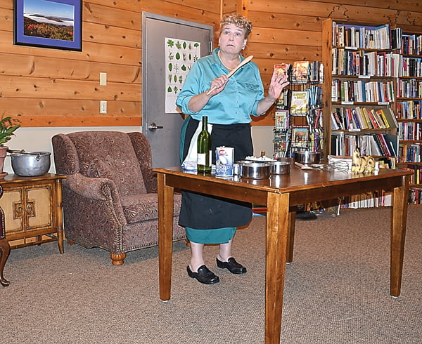 Julia Child, portrayed by Karen Vuranch, cooks up something good as she shares the story of her life during the History Alive! presentation Sunday at the Linwood Community Library. S. Stewart photo