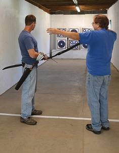 Harmony Outdoors owner Rick McLaughlin, right, gives shooting tips to archer Nelson Hernandez at the indoor shooting range. The business offers top-of-the-line archery equipment as well as a place to hone your archery skills. S. Stewart photo
