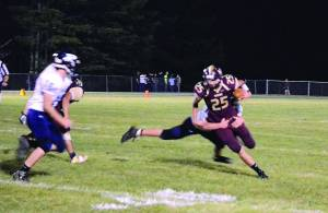 Warrior WR Dalton Irvine breaks free of a Wildcat's tackle and charges into the end zone for the first TD of the night. The Warriors defeated the Wildcats 27-12. Photo courtesy of David Moore.