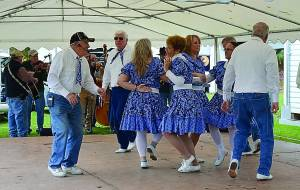 THE APPALACHIAN COUNTRY Cloggers kick up their heels to the music of Juanita Fireball and the Continental Drifters Saturday at Huntersville Traditions Day. C. Moore photos