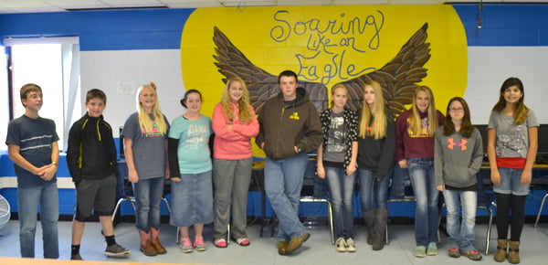 Green Bank Elementary-Middle School students in the advanced art class have traded in drawing paper and canvasses for walls as they decorate the school with colorful murals. Here, with the first finished mural are, from left:Matteus Stitzinger, Hunter Curran, Sienna Bircher, Jennalee Meck, Alexa Taylor, Caleb McCarty, Kira Riggsby, Jenelle Cassell, Kira Bircher, Josie McCarty and Isabella Perrera. Not pictured:Frankie Tawney and Andrea Payton. S. Stewart photo