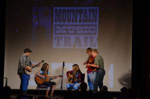 The Young and Restless Pickers perform during the Mountain Music Trail premiere at the Pocahontas County Opera House Thursday. From left to right: Trevor Hammons, Tessa Kiner, Emily Casto, Trevor Jordan and Ben Davis. Photo courtesy of D. Moore