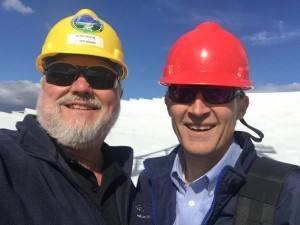 NRAO Business Manager Mike Holstine and Senator Greg Boso braved the wind Wednesday for a brief tour of the Green Bank Telescope.