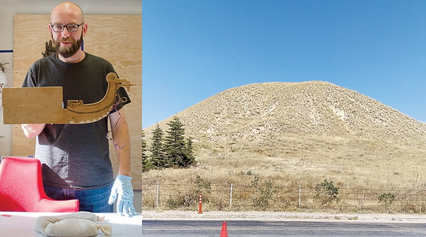 Left photo: As a mount maker at the Penn Museum in Philadelphia, Pennsylvania, Matt Gay works with a lot of ancient artifacts. Above, Gay holds a piece he worked on for an exhibit at the museum. Photo courtesy of Penn Museum Right photo: The Tumulus Midas Mound, or Tumulus MM, is where most of the artifacts were discovered which will be used in the Penn Museum exhibit about Gordium. The tumulus is more than 100 feet tall and was built to conceal a log cabin. Edray native Matt Gay, a mount maker at the museum, traveled to Turkey to assist with collecting the artifacts. Photos courtesy of Matt Gay