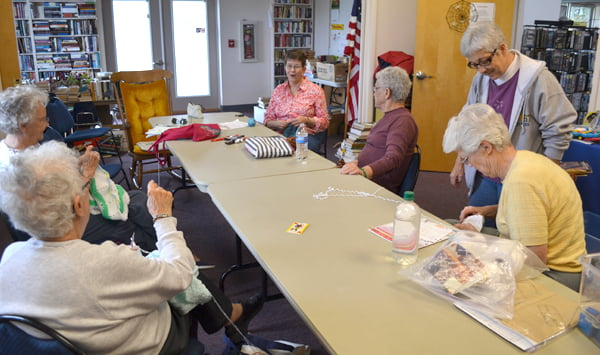 Sharing stories, patterns and a love for knitting and/or crocheting, the knitting group meets twice a month at the Green Bank Library. From left: Joann Fromhart, Hilda Brock, Freda McKean, Dotty McLaughlin, Linda Stewart and Pat Thompson chat and craft. S. Stewart photo