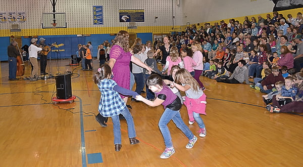 "At the Grandparents Day Celebration  at Green Bank Elementary-Middle School students showed their appreciation for the elders in their lives with an art show and concert. Above, students, joined by art teacher Alison Flegel, participate in a ""dance-off"" to the music of Juanita Fireball and The Continental Drifters, far left. The grandparents voted by applause for the best dancers. S. Stewart photo"