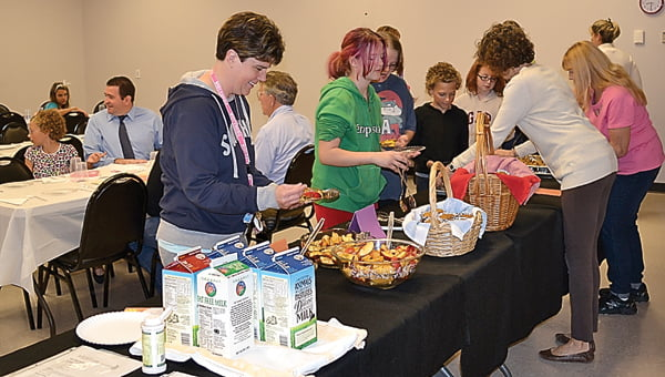 Members of the Marlinton Woman's Club serve breakfast to Marlinton Elementary School fifth grade students and their parents Friday. The breakfast was prepared by the fifth grade as part of their table manners, etiquette and healthy eating lessons provided by the Woman's Club. S. Stewart photo