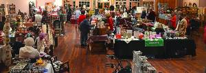 Crafters and vendors await the arrival of holiday shoppers and parade-goers, who filled the aisles at the Holiday Craft Show Fridat night at the Opera House. Photos courtesy of David Moore.