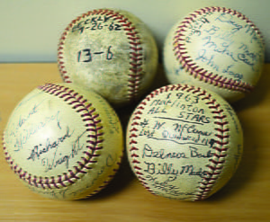 FOUR AUTOGRAPHED BASEBALLS from Little League games, played in the early 1960s, have come home. Rev. George McCune, a volunteer umpire for the league,  saved the mementoes. His sons, Larry and Jim, recently brought the baseballs back to Marlinton. S. Stewart photo