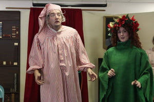 """EBENEZER Scrooge, portrayed by Kyle Walter, and the Ghost of Christmas Present, portrayed by Hannah Redmond. Scrooge regrets his decisions in the Hampstead Stage Company performance of """"A Christmas Carol."""" Photo courtesy of Hampstead Stage Company"""