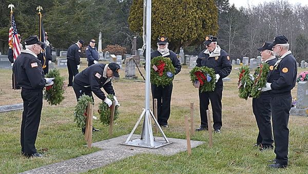 The Pocahontas County Veterans Honor Corps participated in the nationwide Wreaths Across America ceremony Saturday at Arbovale Cemetery. Above, Steve Fierbaugh places a wreath as fellow Honor Corps members Sam Arbogast, Jerry Taylor, Norris Long, Barry Sharp and Willard Pingley wait to place wreaths, as well. S. Stewart photo