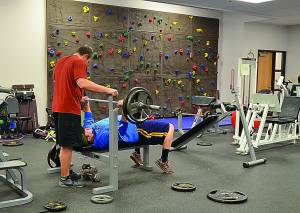 A bench press, climbing wall, treadmills and ellipticals can be found in the Marlinton Community Wellness Center's fitness room. Gym membership fees include instruction from exercise physiologist Paula Zorn. C. Moore photo.