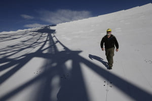 NRAO Business Manager Mike Holstine walks across the dish of the Robert C. Byrd Green Bank Telescope. This hike is only possible on scheduled maintenance days. Observations cease, and a few lucky folks, who aren't afraid of heights, get to take full tour. (AP Photo/Patrick Semansky)