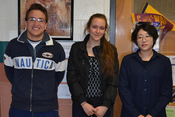 """Pocahontas County High School has two new students for the second semester. Juan Pinto, of Columbia, left; and Seungju """"Julia"""" Lee, of South Korea, right. Senior Lara Baudler, center, and her family are hosting Lee during her stay in Pocahontas County. S. Stewart photo"""
