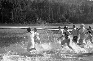 Clad in bathing suits, swimming trunks and, for one woman, a protective layer of bubble wrap, Snowshoe guests and locals sprint into the 42 degree water as a part of the resort's annual Polar Plunge. Photo courtesy of David Moore.