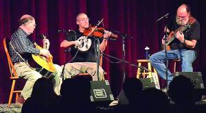 The Elk River Ramblers, from left:Terry Richardson, Paul Marganian and Galen Watts, perform at the annual Opry Night Saturday at the Pocahontas County Opera House. C.D. Moore photo