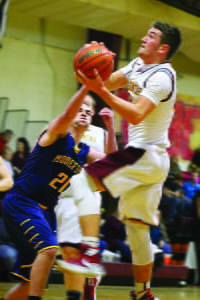 PCHS Senior J.D. Hensler goes for a layup against a Moorefield Yellow Jacket defender at the Senior Night game last Thursday. Hensler was the top scorer, putting a total of 32 points on the board. Photo courtesy of Samantha Collins