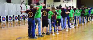 Standing along the 10-meter line, archers from Pocahontas County High School, Fayetteville High School and Buckhannon-Upshur High School prepare to take their first shot. Benjamin Davis and Matthew Pritt were PCHS' top-scoring individuals with fifth and fourth place, respectively. C. D. Moore photo