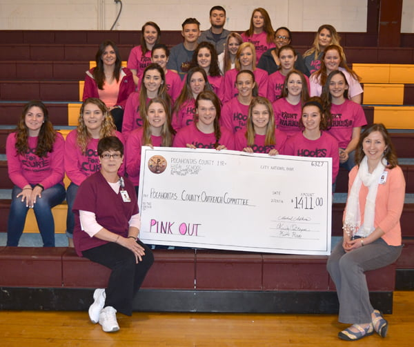 Attending the check presentation for funds raised at the Pocahontas County High School Pink Out were: front row, from left: Pocahontas Memorial Hospital radiology supervisor Cheryl Cain and PMH public relations coordinator Susan Wilkins. Second row, from left: Catlyn Sparks, Brianna Mills, Lindsey Hartzell, Kourtney Cohenour, Sarah Ryder and Tiffany Hoover. Third row, from left: Marlee McLaughlin, Kayleigh Arbogast, Mary Kelley, Emalee Arbogast and Courtney Dunbrack. Fourth row, from left: Mia Ellison, Michelle Murphy, Melissa Murphy, Megan Galford, Brittney Sharp and Emily Boothe. Fifth row, from left: Caitlin Keatley, Tiler Mortensen-Smith, Kaila Peck, Michaela Everette and Kaylin Murray. Fifth row, from left: Gavin Gilmore and Samantha Lane. S. Stewart photo