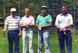 "GOLFERS, COMPETITORS AND lifelong friends – the ""whole"" in one – at Pocahontas County Country Club. L to r: Philip Cain, Harper Nelson, Fred Burns, Jr. and Bill Gay. Photo courtesy of Fred Burns, Jr."