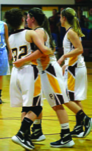 Lady WarriorS Melissa Murphy, Kayleigh Arbogast and Mary Kelley celebrate Arbogast's successful foul shot against the Pendleton County High SchoolLady Wildcats February 24. The Lady Warriors were victorious and advanced to sectionals, only to be defeated by East Hardy High School February 27. Photo courtesy of Samantha Collins
