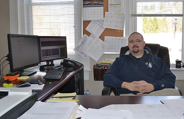 Five years after a serious accident left him with a broken neck, Michael O'Brien now sits tall in his new job as 911/OEM director for Pocahontas County. While he still uses a wheelchair most of the time, O'Brien has progressed to walking with arm crutches or a walker on a daily basis. S. Stewart photo