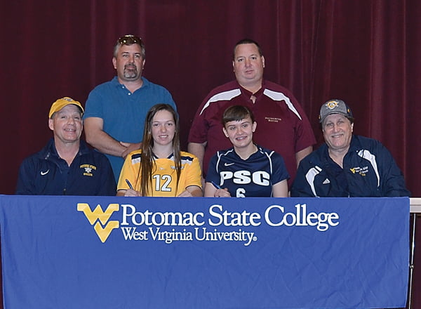 Two Pocahontas County High School Lady Warriors signed letters of intent to play soccer at Potomac State College. Seated from left: PSC head coach Mark Sprouse, Kayleigh Arbogast, Brittany McMillion and PSC assistant coach Donnie Amann. Standing, from left: youth soccer coach Howard Walker and PCHS soccer coach Shannon Arbogast. S. Stewart photo